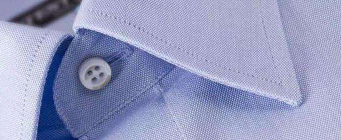 为什么衬衣最上面的扣眼是横向的?